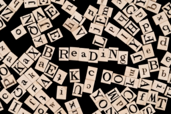 Random Alphabet, with the word 'Reading'